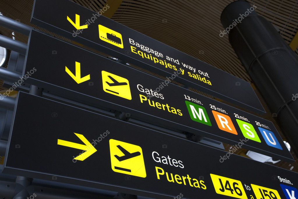 Airport Baggage and Gate Sign at Barajas Airport in Madrid — Stock Photo #4101052
