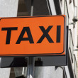 Stock Photo: Orange taxi sign