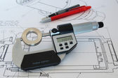 Micrometer on technical drawing — Stock Photo