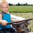 Little boy is steering a tracor. — Stock Photo #4139665