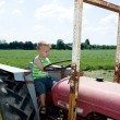 Driving a tractor — Stock Photo