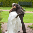 Kissing his bride — Stock Photo
