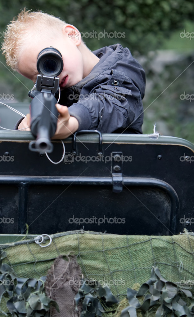 Young soldier is aiming his gun. — Stock Photo #4139667