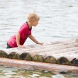 Young boy is pushing his raft — Stock Photo