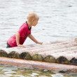 Royalty-Free Stock Photo: Young boy is pushing his raft