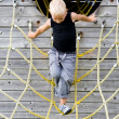 Little boy climbing in the ropes — Stock Photo