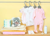 Clothes and accessories for newborn — Stock Photo