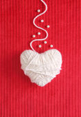 Heart of Knitting on red - Valentine's card — Stock Photo