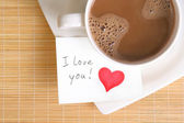 A love note with a cup of coffee — Stock Photo