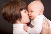 Mother kissing her little baby — Stock Photo