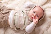 Cute baby sucking fingers — Stock Photo