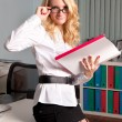 Stock Photo: Sexy young business lady in office