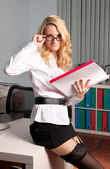 Sexy young business lady in office — Stock Photo