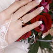 Stock Photo: Bride holding a red rose