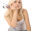 Very beautiful blonde with a bunch of colored pencils on white background — Stock Photo