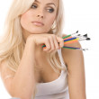 Very beautiful blonde with a bunch of colored pencils on white background — Stock Photo #4315730