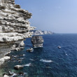 France, Corsica, Bonifacio, view of Bonifacio rocky coast and luxury yacht — Stock Photo