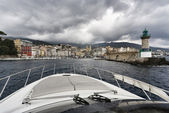 France, Corsica, Bastia, view of the port light and the town from the sea — Stock Photo