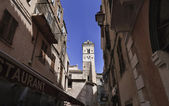 France, Corsica, Bonifacio, buildings and the cathedral bell tower in the o — Stock Photo