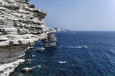 France, Corsica, Bonifacio, view of Bonifacio rocky coast and luxury yacht — Stock Photo