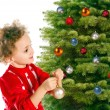 Little girl dresses up a christmas-tree — Stock Photo #4202161