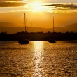 Two sailboats anchored at sunset — Stock Photo