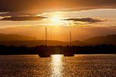 Two sailboats anchored at sunset — Stock Photo