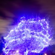 Stock Photo: Blue tree illuminated
