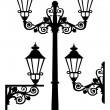 Set of silhouettes of lanterns or street lamps — Stock Vector