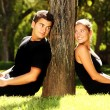 Young couple and a tree — Foto de Stock