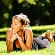 Young woman lying in the park — Stock Photo