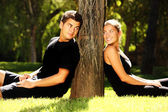 Young couple and a tree — Stock Photo