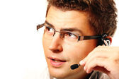 Young man with headset talking — Stock Photo