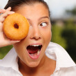 Young wife and a donut — Stock Photo #4008955