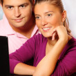 Stock fotografie: Young married couple searching the Internet