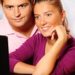 Stok fotoğraf: Young married couple searching the Internet