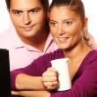 Young married couple working on laptop together — 图库照片