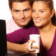 Royalty-Free Stock Photo: Young married couple browsing the Internet