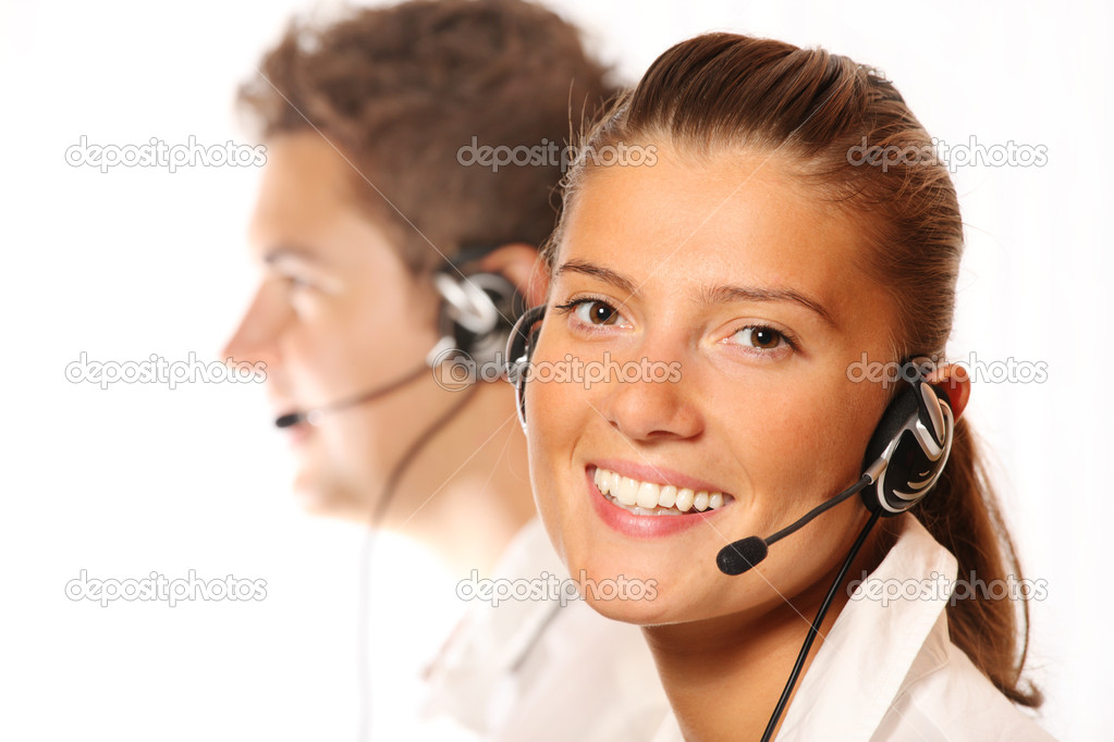 A picture of a team of young call center workers, pretty woman in the foreground  Foto Stock #4017163