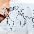 Female hand drawing a world map — Stok fotoğraf #4081590