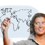 Beautiful woman drawing world map — Stock Photo #4087416