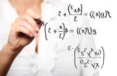 Toung teacher solving a mathematical equation — Photo