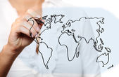 Female hand drawing a world map — Stok fotoğraf