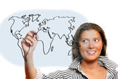 Beautiful woman drawing world map — Stock Photo