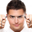 Young businessman holding glasses — Stock Photo #4106953
