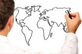 Young businessman drawing a world map — Stok fotoğraf
