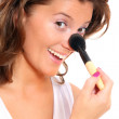 Cute woman putting on her makeup — Stock Photo