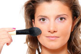Pretty Woman putting on makeup — Stock Photo