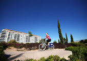 Young woman cycling in the park — Stock Photo