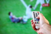 Male hand holding a remote control — Stock Photo